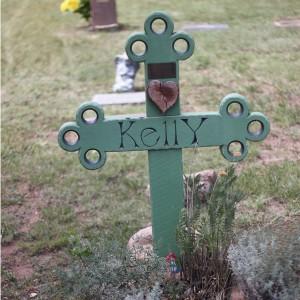 Wooden cross grave marker.